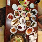 Our dinner in Gongju: fifteen small plates, plus leaf and flower wraps and bulgogi. There's no room on the table, and the hot pot stone rice isn't even here yet!