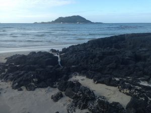 Juxtaposing volcanic rock and sand