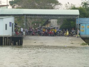 A crowd awaiting the ferry
